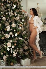 Sanita Ramira Unwraps Herself Under The Xmas Tree