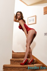 Jennifer Teasing On The Stairs In Her Red Bodysuit