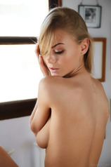 Stunning blonde beauty Nancy A sits in her room