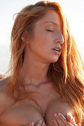 Stunning Redhead Girl On The Beach