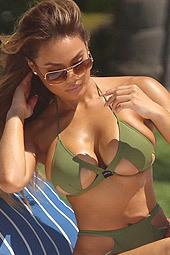 Daphne Joy Tanning Her Curvy Body In Tiny Green Bikini Poolside