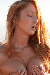 Stunning Redhead Girl On The Beach