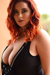Busty Redhead Babe Lucy Vixen