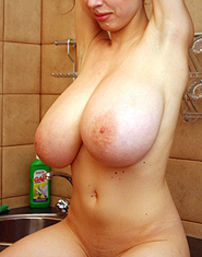 Gigantic Natural Tits In The Kitchen